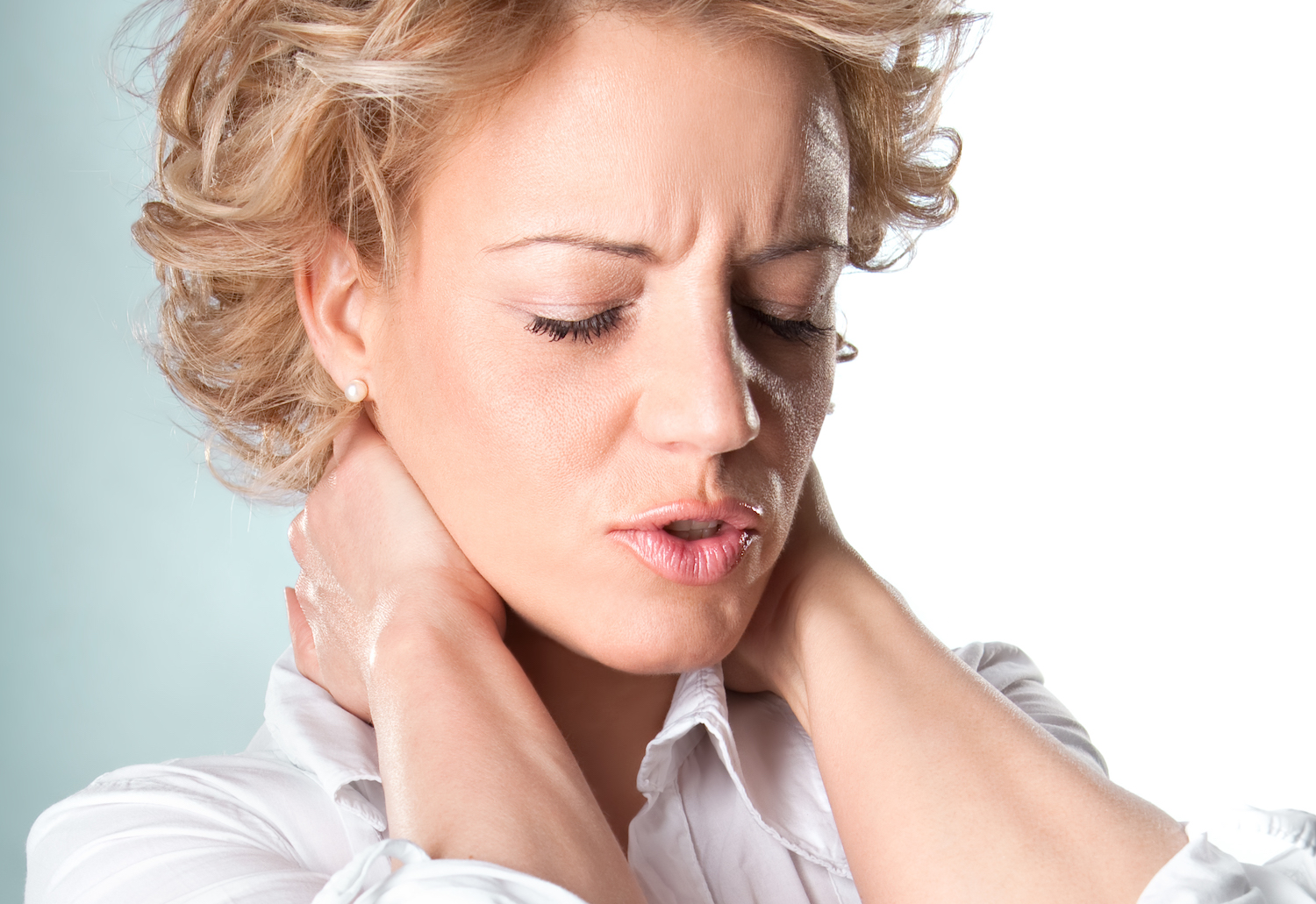 Woman with pain in neck